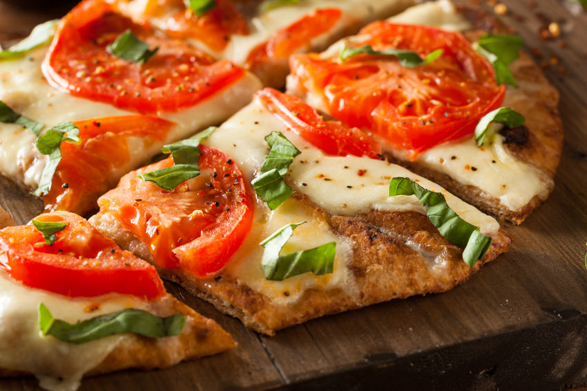 38374552 - homemade margarita flatbread pizza with tomato and basil